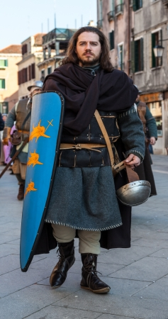 sestiere: Venice,Italy-Februray 26th, 2011: Image of a medieval soldier marching in a medieval characters parade in Venice on Sestiere Castello, during The Canival days.