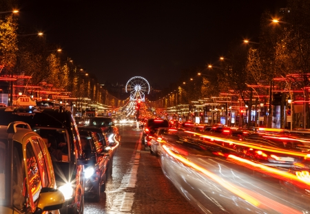 concorde: December illumination and traffic lights on the Avenue des Champs in Paris,Europe. In the distance you can see the Ferry wheel located in Place de la Concorde.