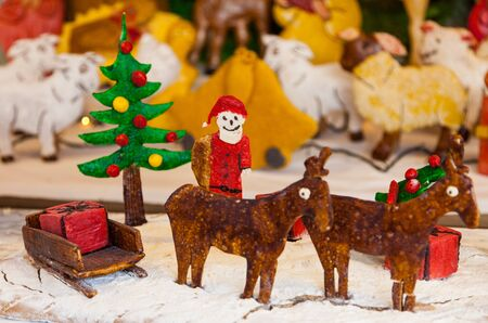 A funny Cristmas scene with figurines made by ginger bread. photo