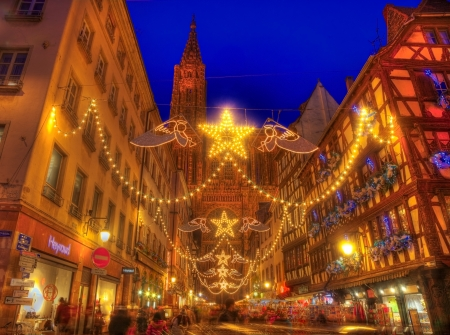 Strasbourg,France- December 12, 2012: The crowded Rue Merciere in Strasburg during the festive winter holidays illumination.During December in Strasbourg are 12 Christmas Markets which make this city a real Christmas Capital. Editorial