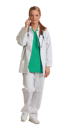 unifrom: Image of a young female doctor on the phone walking to the camera, isolated against a white background. Stock Photo