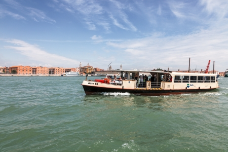waterbus: Venice,Italy- July 28, 2011:  Image of Il Vaporetto with tourists sailing on the Grand Canal in Venice. Il Vaporeto is a motorized waterbus which ply regular routes along the major canals and between the citys islands. Editorial
