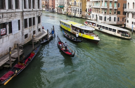 waterbus: Venice, Italy- July 28,2011: Gondolas and ships full with tourists floating on the Grand Canal in Venice. Editorial