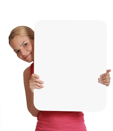 holding blank sign: A young woman  holding an empty white bill board against a white background. Stock Photo