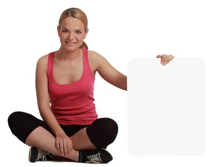 A young woman  holding an empty white bill board against a white background. Stock Photo - 17341118