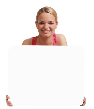 A young woman  holding an empty white bill board against a white background. Stock Photo - 17341116