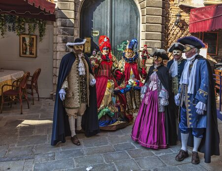 Venice,Italy- February 18, 2012: Group of disguised people wearing various costumes and masks during The Venice Carnival.