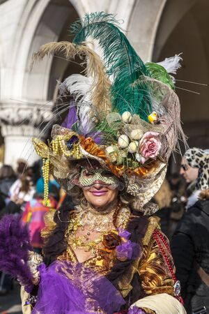 eccentric: Venice, Italy- February 18th, 2012: Environmental portrait of a woman with a eye mask (Colombina) and a very sophisticated disguise in Venice during The Carnival days. Editorial