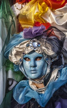 Venice, Italy- February 18th, 2012: Environmental portrait of a person wearing a blue mask during the Venice Carnival days. Stock Photo - 17523275