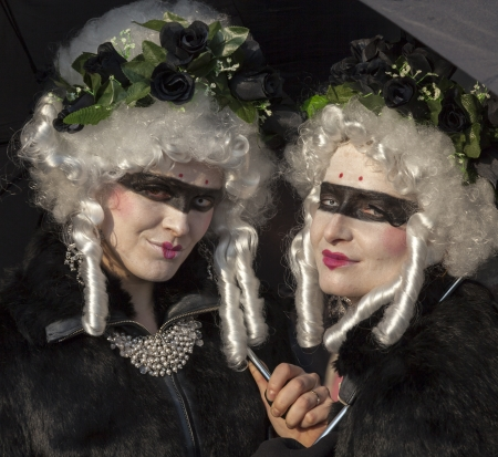 Venice, Italy-February 18,2012: Portrait of a two women disguised during the Venice Carnival days.