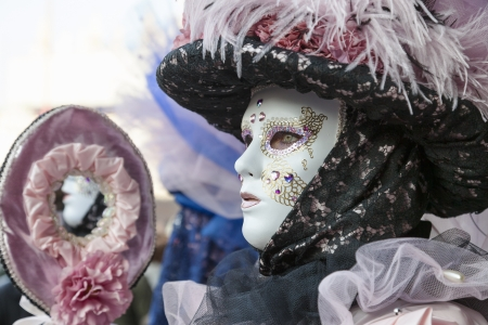 Venice, Italy-February 18,2012: Portrait of a woman wearing a traditional disguise with a mirror in Venice during The Carnival days.