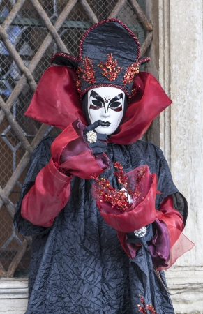 specific: Venice, Italy- February 19th, 2012: Portrait of a person disguised in a specific costume and mask during the Venice Carniva days.