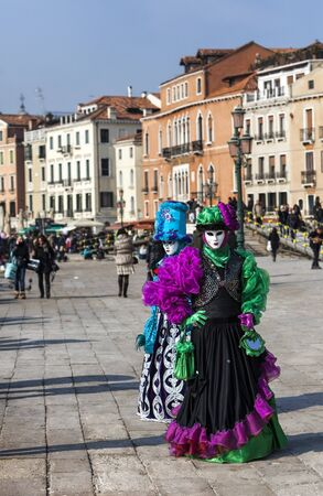 sestiere: Venice, Italy- February 18th, 2012: Two disguised people posing in Sestiere Castelo during the Venice Carnival days.