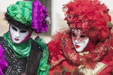 Venice, Italy- February 18th, 2012: Portrait of two person in traditional masks and cotumes during the Venice Carnival days. Stock Photo - 17949414