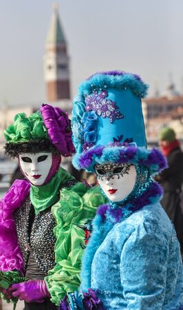 Venice, Italy- February 18th, 2012: Portrait of two person in traditional masks and cotumes during the Venice Carnival days.