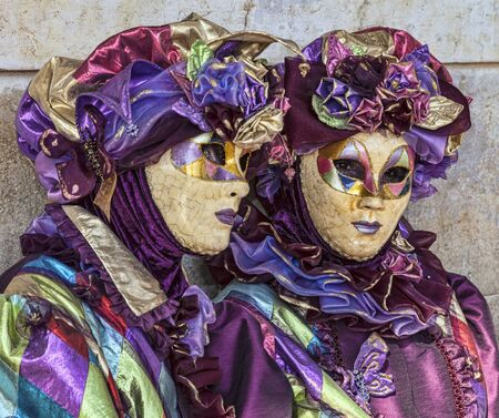 Venice, Italy- February 18th, 2012: Portrait of two persons in traditional masks and costumes during the Venice Carnival days.