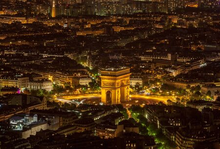 triumphal: Aerial view of the Triumphal Arch area in Paris during the night.This very famous monument of Europe is located at an intersection of 12 roads in the big city.
