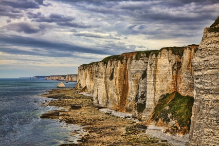 low tide: Specific cliffs in Etretat in the Upper-Normandy region in Northern France, during the low tide time.