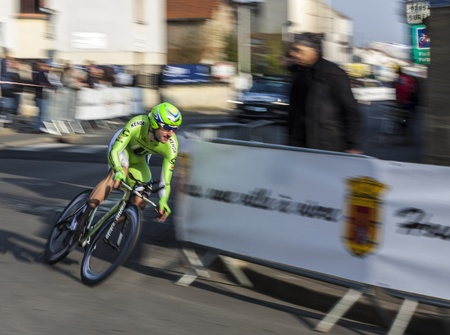 Houilles, France- March 3rd 2013: Panning image of a cyclist from Cannondale team, riding during the prologue of the cycling road race Paris- Nice 2013 in the streets of Houilles, near Paris, on March 3rd 2013. Stock Photo - 18321496
