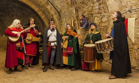 Rodemack,France- December 09, 2012:Medieval band playing indoor in a rocks cave during a historical reenactment festival in Rodemack, France.