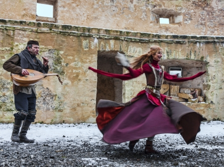 Rodemack,France- December 09, 2012: A couple disguised as cave-people performing for entertaining the spectators in Rodemak, during a historic reenactment close to the fortress walls in Rodemack,France.