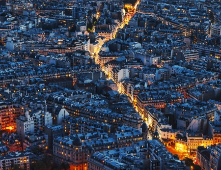 roof light: Aerial night view of an illuminated street between crowded buildings in Paris