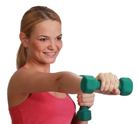 strong arm: Portrait of a young blonde woman doing exercise with dumbbells isolated against a white background.