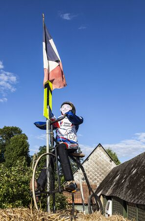 velocipede: Bailleau-le-Pin,France-July 20,2012:Mascot of a cyclist, riding a velocipede, decorating the yard of a rural household, one day before the passing of the peloton in the 19th stage of Le Tour de France 2012, a time trial between Bonneval and Chartres.