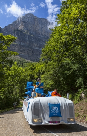 Col du Granier,France-July 13th, 2012:The fancy truck of Ibis Budget Hotels during the passing of the Publocity Caravan on the category I climbing route to mountain pass Ganier in the 12 stage of the 2012 edition of Le Tour de France, the biggest cycling