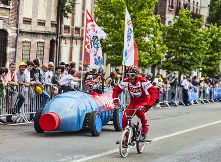 Saint Quentin, France, July 5th 2012: Funny character riding a BMX bicycle, promoting Vittel, a famous French brand of  of bottled water,during the passing of publicity caravan in Saint Quentin during the stage 5th of Le Tour de France 2012.