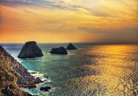 Beautiful sunset colors and reflections on the Pen-Hir Cape, Brittany photo