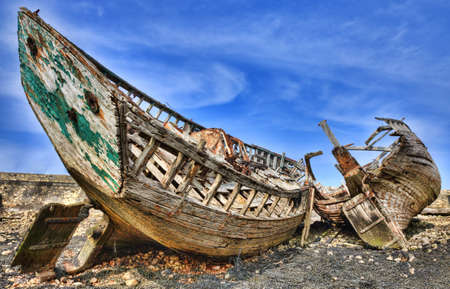 Wrecks of wooden ships on an empty shore at the Atlantic Ocean. photo
