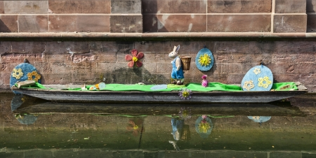 specifically: Colmar,France- April 23rd, 2011: A boat funny decorated specifically for Easter on a canal in Colmar in Alsace, France.