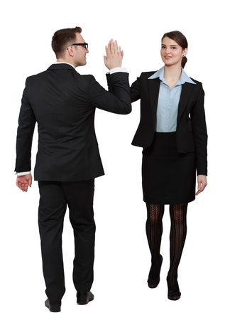 five people: Young business couple celebrating their success giving each other a high five, against a white background. Stock Photo