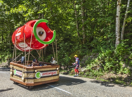 Col du Granier,France-July 13th, 2012: Antargaz fancy vehicle during the passing of the Publicity Caravan on the category I climbing route to mountain pass Ganier, in the 12 stage of the 2012 edition of Le Tour de France, the biggest cycling race in the w