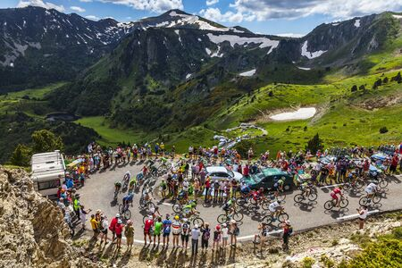 Col de Pailheres,France- July 07 2013: The peloton climbing the road to Col de Pailheres in Pyrenees Mountains during the stage 8 of the 100 edition of Le Tour de France on 7 July 2013.