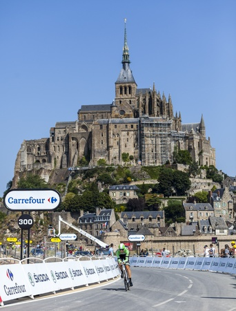 Le Mont Saint Michel,France- July 10,2013: The Belgian cyclist Sep Vanmarcke from Belking Pro Cycling Team cycling in front of Le Mont Saint Michel Monastery during the stage 11 of the edition 100 of Le Tour de France in 2013.