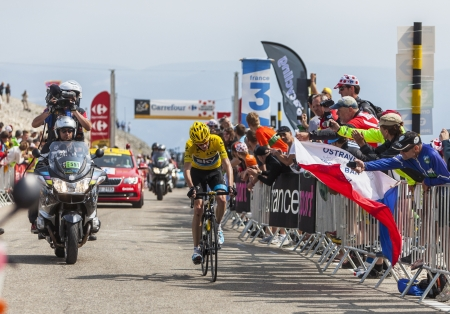 Mont Ventoux, France- July 14 2013: The British cyclist Christopher Froome (Sky Pro Cycling Team) wearing the Yellow Jersey, climbing the last kilometer of the ascension to Mont Ventoux during the stage 15 of the 100 edition of Le Tour de France 2013. Fro