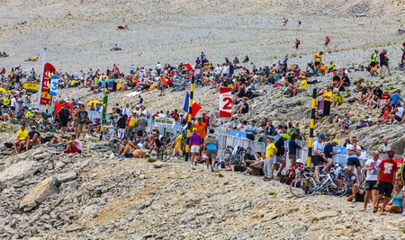 Mont Ventoux, France- July 14 2013: Crowd of people waiting for the cyclists on the rocky slopes of Mont Ventoux during the stage 15 of the edition 100 of Le Tour de France 2013.