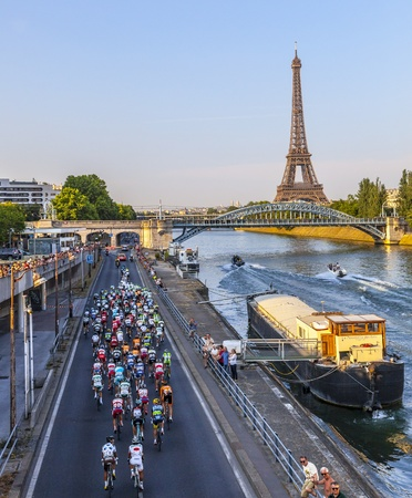 Paris, France- July 21st, 2013: The peloton riding on the Seine riverside near the Eiffel Tower during the last stage of the 100th edition of Le Tour de France 2013, in Paris