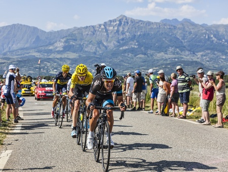 Col de Manse, France- July 16, 2013: Three cyclists Richie Porte (front), Christopher Froome (Yellow Jersey) and Alberto Contador (behind) riding fastly on a plain road after the ascension to Col de Manse during the stage 16 of 100th edition of Le Tour de