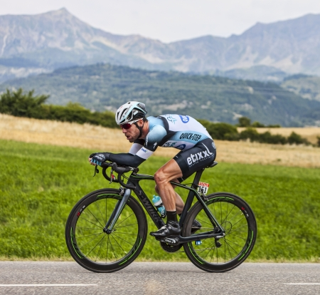 Chorges, France- July 17, 2013: The Manx cyclist Mark Cavendish from Team Omega Pharma-Quick Step pedaling during the stage 17 of 100th edition of Le Tour de France 2013, a time trial between Embrun and Chorges.