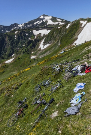 apparition: Port de Pailheres,France- July 6, 2013  Bicycles and equipment of amateur cyclists are on the slopes of the moutain at the Col de Pailheres in Pyrenees before the apparition of the peloton during the stage 8 of edition 100 of Le Tour de France 2013