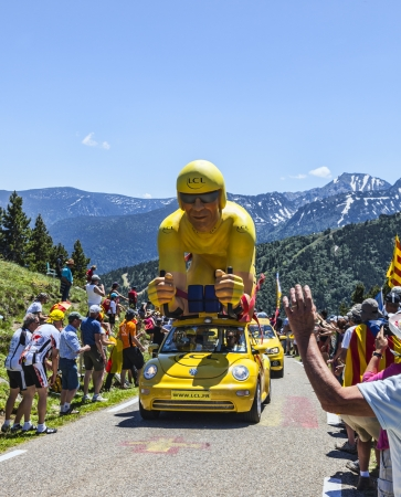 apparition: Port de Pailheres,France- July 6, 2013  LCL  Le Credit Lyonnais  car during the passing of the publicity caravan on the category H climbing route to the Col de Pailheres in Pyrenees Mountain before the apparition of the peloton during the stage 8 of editi