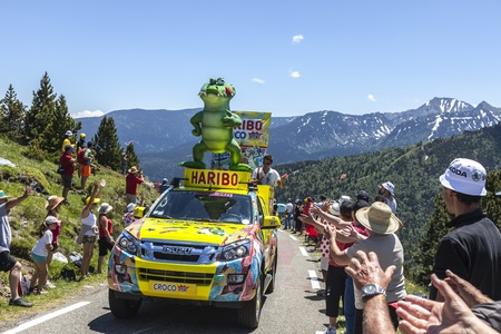 Port de Pailheres,France- July 06 2013:Haribo car during the passing of the advertising caravan on the climbing route to mountain pass Pailhere in Pyrenees Mountains during the 8th stage of the 100 edition of Le Tour de France, the biggest cycling race in