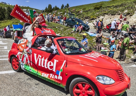 Port de Pailhere,France- 6 July, 2013  Funny car driving on the road to Col de Pailehres  Pyrenees Mountains , promoting Vittel, a famous French brand of bottled water,during the passing of publicity caravan in the stage 8th of edition 100 of Le Tour de F