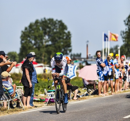 sain: Le Poont Landais,France-July 10, 2013  The Portuguese cyclist  Rui Alberto Faria da Costa,from Movistar Team, pass through a group of spectators during the stage 11 of the edition 100 of Le Tour de France 2013, a time trial between Avranches and Mont Sain Editorial