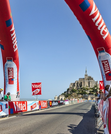 Mont Saint Michel, France- July 10, 2013  Image of the road to Mont St  Michel monastery during the stage 11 of the edition 100 of Le Tour de France in 2013