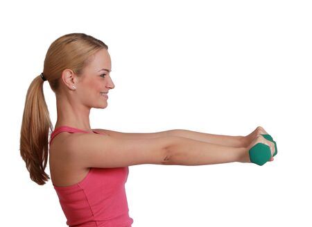 Profile of a young blonde woman doing exercise with dumbbells isolated against a white background. photo
