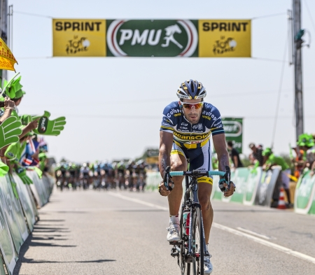 intermediate: Saint Aoustrille, France-July 12,2013  The Spanish cyclist Juan Antonio Flecha Giannoni from  Vacansoleil-DCM team passing in the 4th position the finish line of the intermediate sprint during the stage 13 of the edition 100 of Le Tour de France 2013 in S
